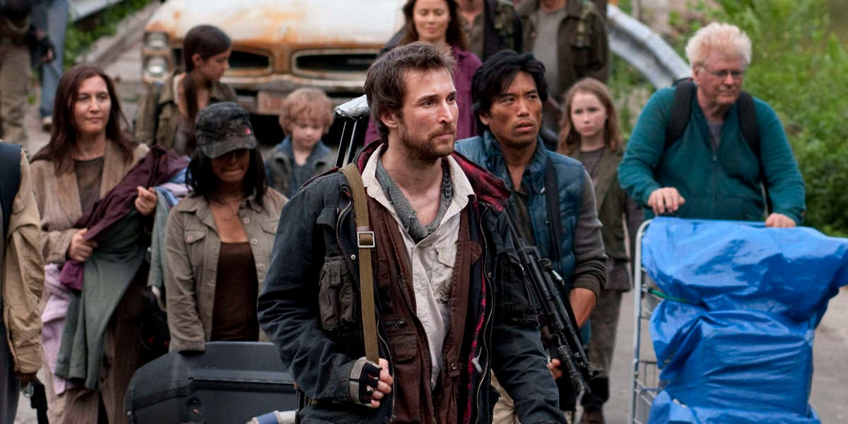 A group of survivors march to safety.