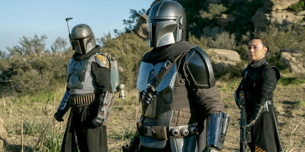 The Mandalorian stands with Boba Fett and Fennec Shand.