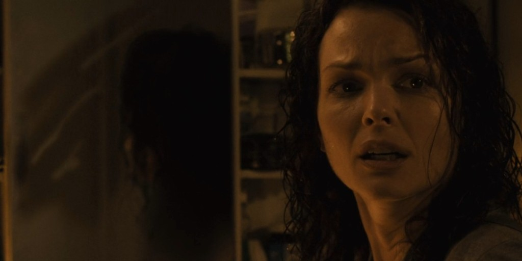 Allison Kerry senses an intruder in her home in Saw 3.