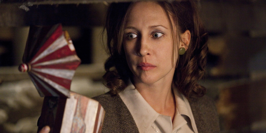 Lorraine Warren (played by Vera Farmiga) looks at a music box in the basement.