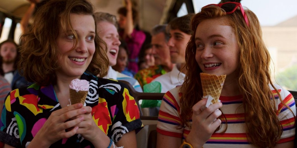Eleven and Max enjoy ice cream on the bus.